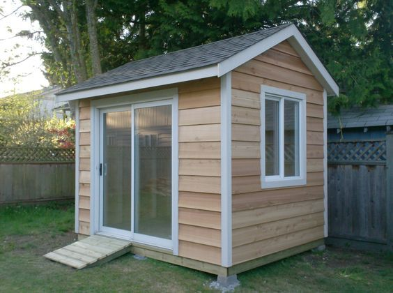 this is an 8x10 shed with cedar siding with a sliding door