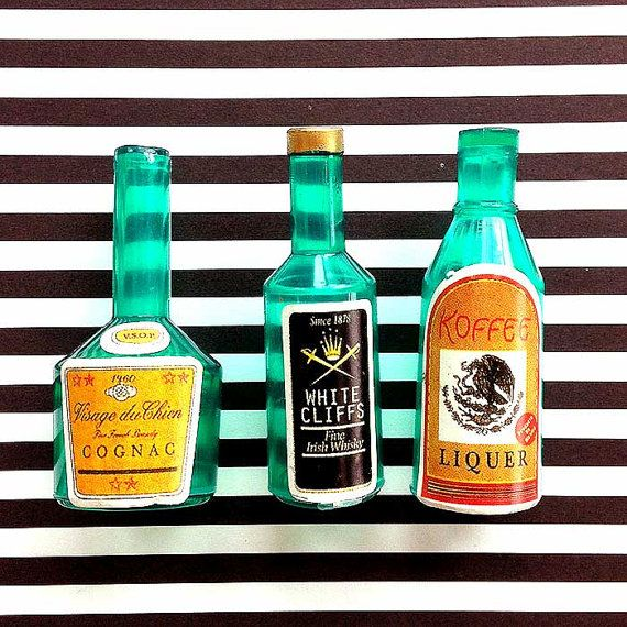 Its party time with these miniature liquor bottles! The bottles are sturdy plastic with a retro sticker label. Tie one of these on a package for