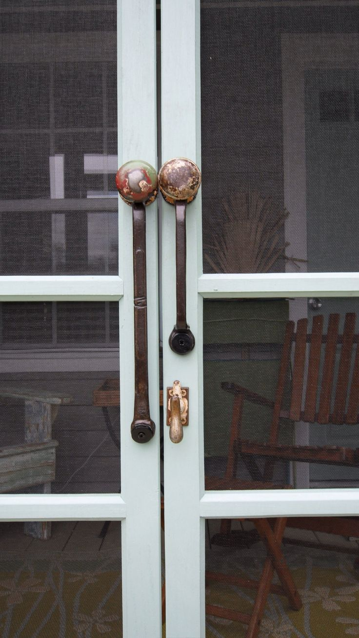 In the kitchen antique wrenches are used as cabinet door handles and - Wrenches And Doorknobs Screen Door Handles