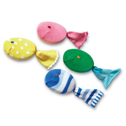 #diy Use for outgrown or misfit socks.    Site makes them into soap scrubbers, but you could make a fish throw game, or add numbers for other possibilities.  Upcycling toddler baby