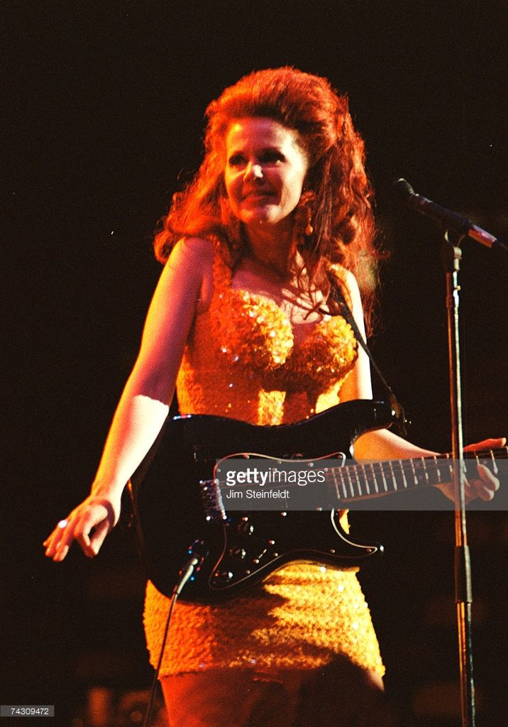Singer Kate Pierson of the rock and roll band the 'B-52's' perform onstage in 1990 in Minnesota.