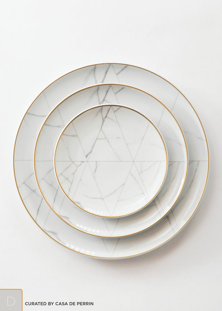 "An unexpected dinnerware line created by French designer Coline le Corre. A refined, geometric approach, inspired by the noble marble of Carrara.        * Dinner Plate (11"")     * Salad/Dessert Plate (8.75"")     * Bread Plate (6.4"") photography"