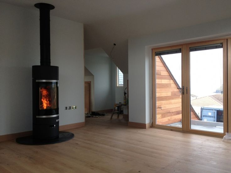 Scan 85 in an open plan living room, installed by Kernow Fires onto a bespoke honed slate hearth.   #scan #stove #fire #wood #burner #freestanding #bespoke #honed #slate #hearth #twin #wall #flue #system #flames #modern #contemporary #house #home #kernowfires #wadebridge #redruth #cornwall