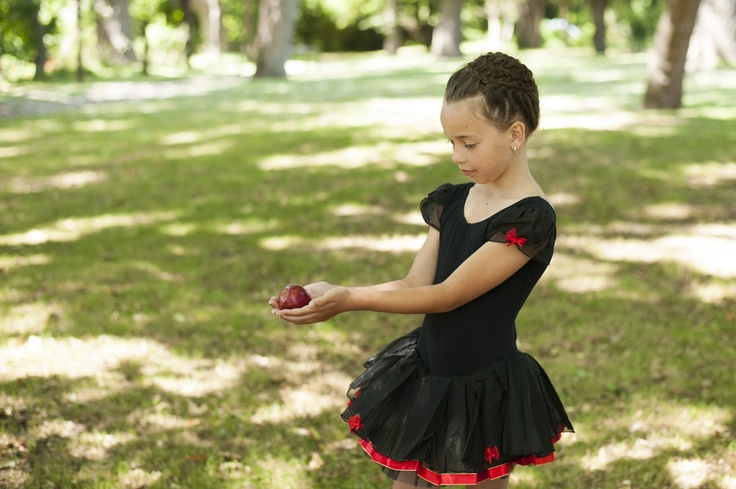 SNOW WHITE TUTU An elegant jett black tutu, accented with a red bow at each sleeve. A soft tulle   skirt, with stunning red edging creates a glamorous portrayal of Snow White only $59.99 email Heidi@rosebuds.net.nz
