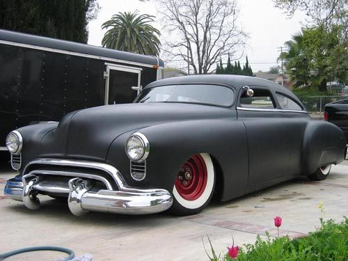 1949 Oldsmobile - We had this, and a shiny black too. My Mom bought it as a surprise for my Dad for Christmas. I was 7 and I don't think my father even knew how to drive yet (but not sure about that). I remember a lot of Sunday afternoon drives :)