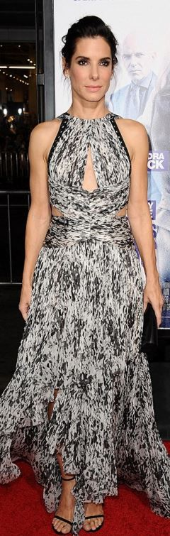 Who made  Sandra Bullock's white pleated gown, black sandals, and jewelry?