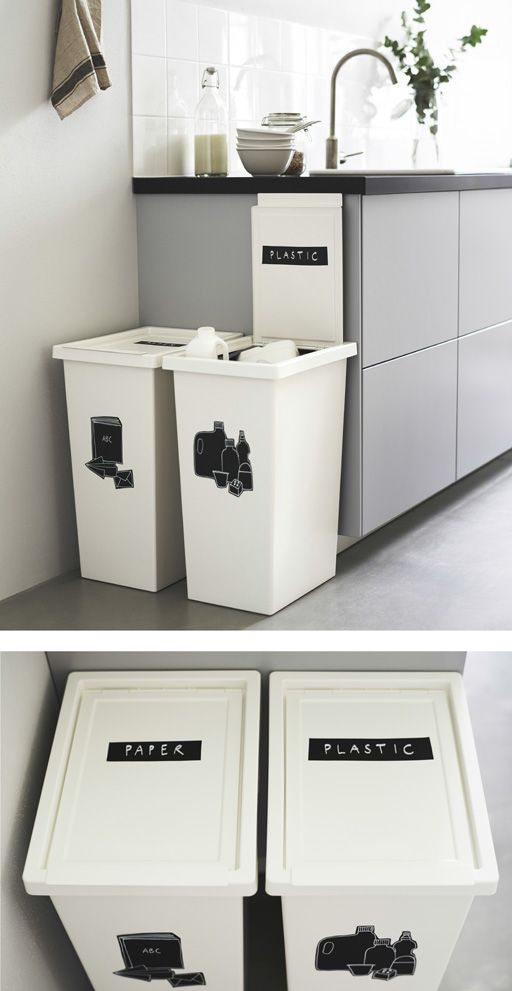 Two large, white bins next to a kitchen counter ar…