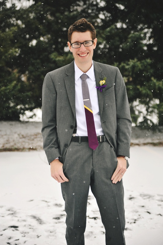Grey suit, homemade tie that incorporated both the purple and the hint of yellow, and homemade billy button boutineers to pull the look together. Photo Credit: Rachel Gabrielse Photography