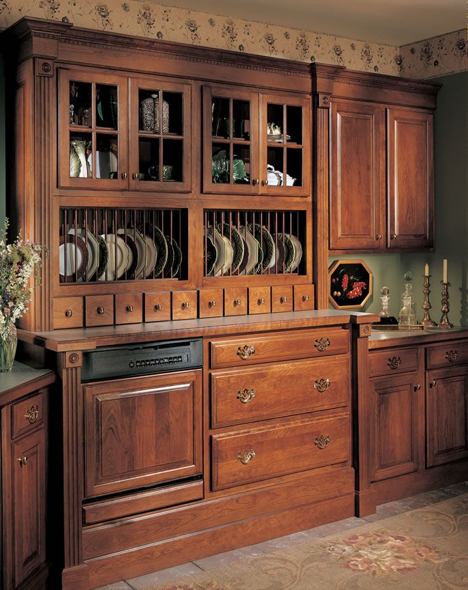 Dark Kitchen With Plate Organization, Glass Doors, And Spice Drawers. Kitchen  Design Group In Shreveport, LA Is An Authorized Dealer Of Quality Cabinets.