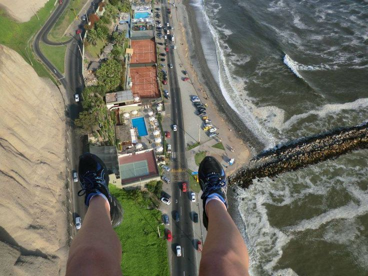 Our intrepid travel guide, Kelly Hurst, paraglides over Lima, #Peru