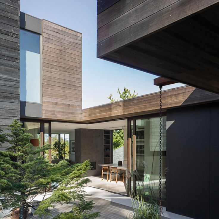 Seattle Architecture Firm Mw Works Has Helped A Couple. Fireplace Walls. Above Fridge Cabinet. Silgranit. Gray Cabinets. Industrial Kitchen Lighting. Flush Mount Chandeliers. Large Parcel Drop Box. Gold Entry Table