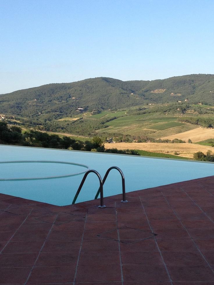| castello vicchiomaggio | infinity pool in chianti reagion | summer