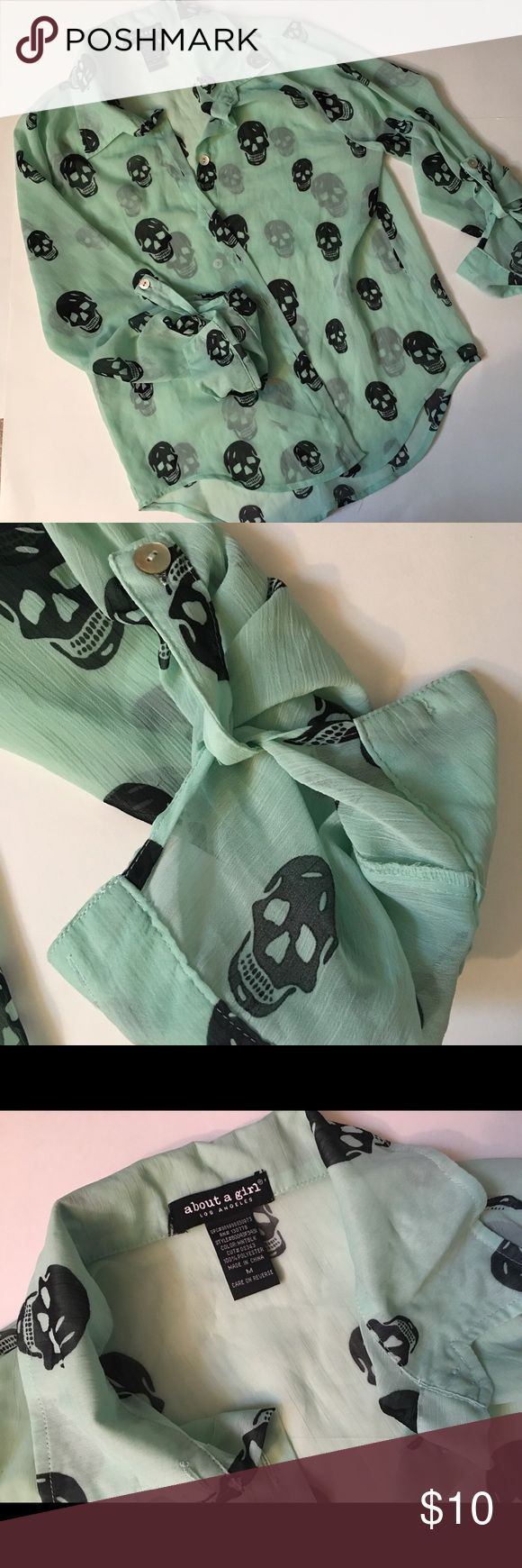 Sheer Mint blouse with Skulls About a Girl Los Angeles Sheer Blouse with Blue Skulls.  This airy blouse buttons up to 3/4 sleeve. All About a girl Los Angeles Tops Blouses