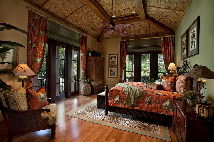 Love the cozy warm feeling I get from the decor of this tropical bedroom by Kurtz Homes Naples