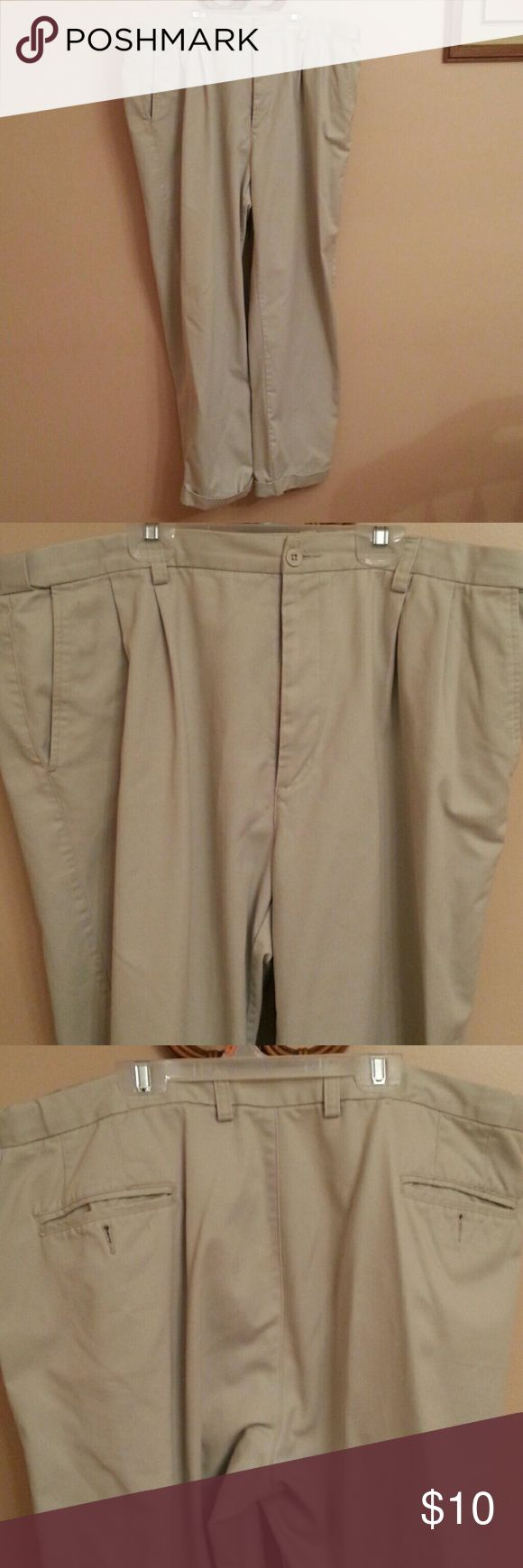 Men's Dress slacks Cream/tan men's dress slacks.  Pleats in the front pockets in front and back.  Cuffs at the bottom of pants.  A couple of small spots but still in good condition. Areas are on back of legs. puritan Pants Dress