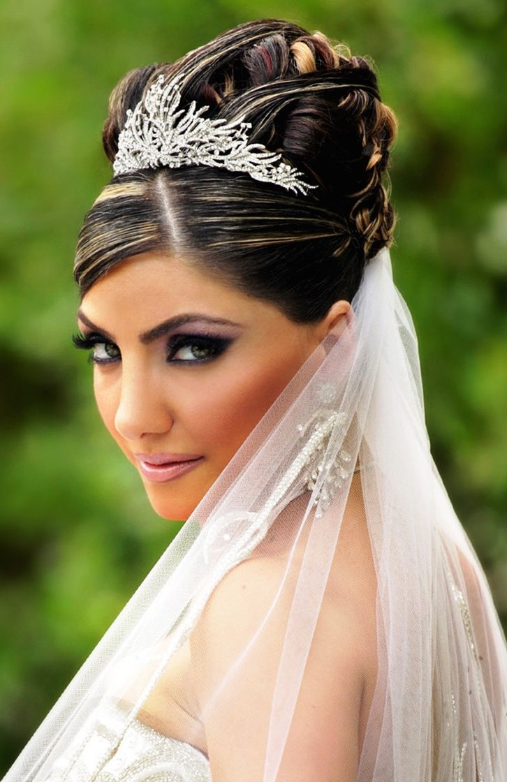 Bridal tiaras and veils - Bride S Ornate Braided High Updo Bridal Hair Ideas Toni Kami Wedding Hairstyles Swarovski Tiara