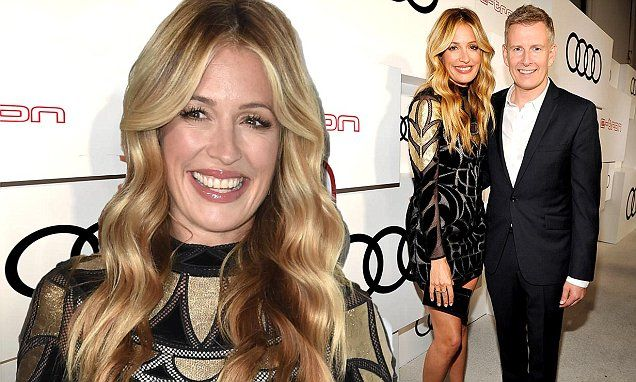 Pregnant Cat Deeley cosies up to husband Patrick Kielty