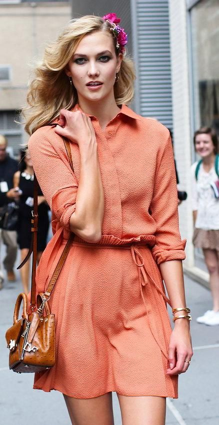Karlie Kloss in a DVF dress and with a DVF bag