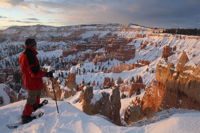 Visitors flock from all over the world to see Bryce Canyon National Park's natural amphitheaters filled with pinnacles, spires and the spooky limestone formations called hoodoos. They mostly come in the agreeable high-country summer, yet some claim winter is the best time. Though Mother Nature doesn't always cooperate with the gift of snowfall, when she does, it makes every detail of this colorful landscape seem to pop out of the white background like a watercolor by an expert artist.