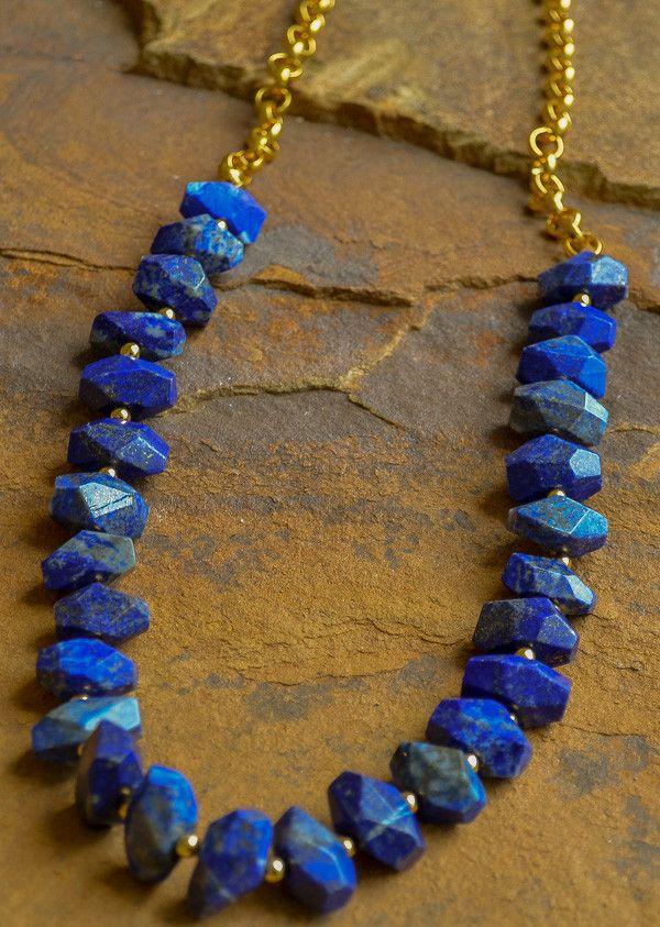 """Chunky faceted blue lapis, gold beads and chain. Approximately 22"""" in length. Perfect for layering or wearing alone."""