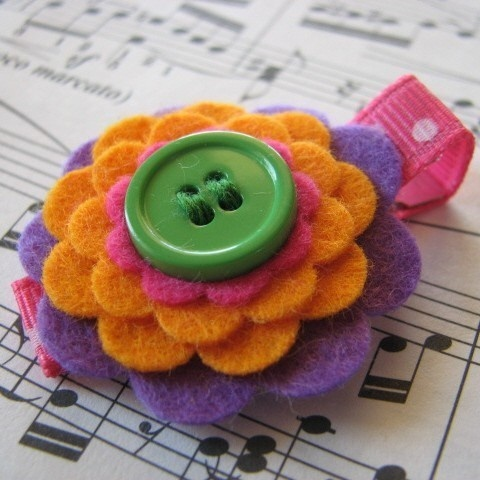 clip  http://www.etsy.com/listing/43427003/samantha-wool-felt-and-button-hair?ref=sr_gallery_16_search_submit=_search_query=clip++purple+orange+pink+green_view_type=gallery_ship_to=US_page=12_search_type=handmade_facet=handmade