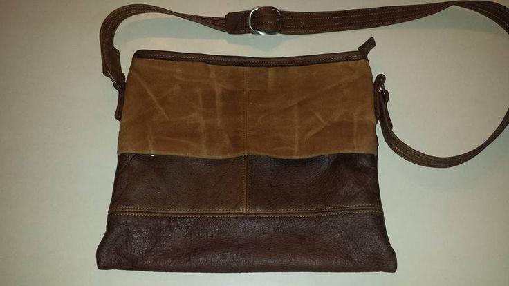 G7 For the ladies...a prototype of a fully lined vintage distressed leather bag with natural raw canvas that's been tea-stained and waxed. It has a large exterior zip through pocket, a zip through pocket inside with a seperate cell and make-up pouch...lemme know girls!! www.g7utility.com