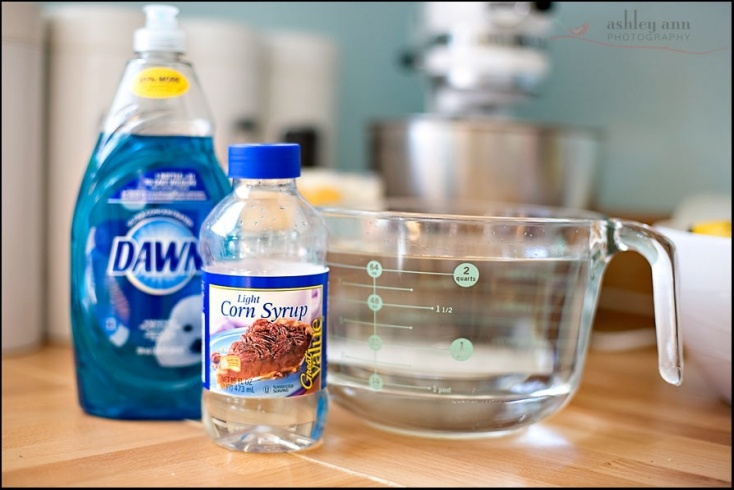BUBBLES! 1 1/2 quarts of water, 1/2 cup light corn syrup, 1 cup of liquid dish soap