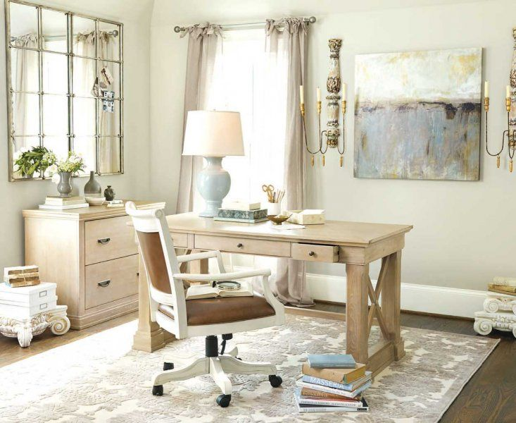 A neutral color palette and feminine accents makes this home office a perfect spot for the lady of the house.