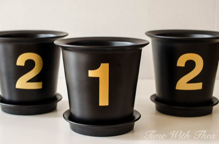 "Make your own beautiful house number flower pots using black IKEA JUJUBÄR plant pots and metallic gold spray painted 3"" number stickers / timewiththea.com"