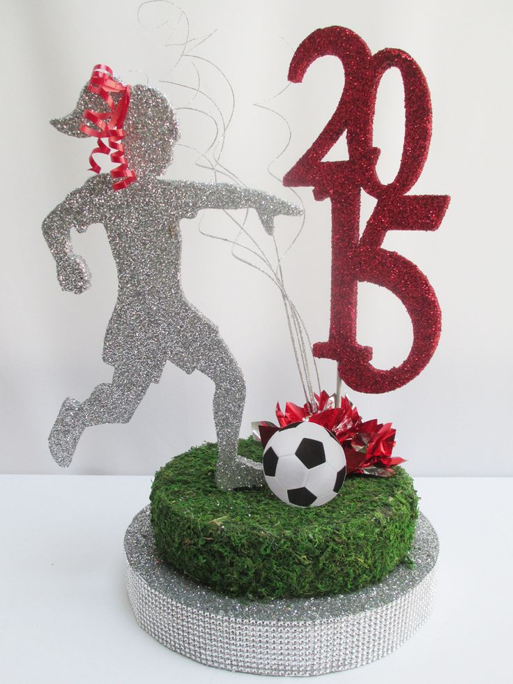 Our soccer girl cutout is great for an end of the year soccer banquet or as a graduation centerpiece. We used a grassy moss for the base where she is kicking the ball to give it the real feel of a …