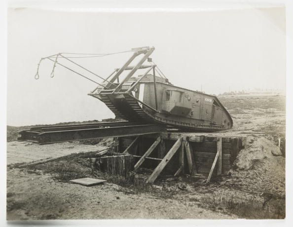 Snapshot photograph of a British Mark I tank bridging a trench taken by an unknown photographer in about 1917.