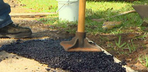 Watch this video to see how to repair a hole in an asphalt driveway using asphalt repair material.