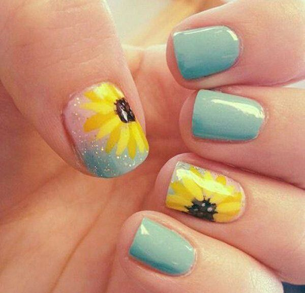 Sunflowers are also in this summer! Coat your nails with this awesome combination of blue shades, glitters and a huge sunflower painted on top of it. The nails start off with a matte shade of light sky blue, accented with sparkles and a bright yellow sunflower as the highlight. Cute and pretty looking, you can never go wrong with this nail art choice.