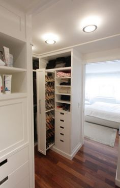 A very clever hidden shoe drawer. A great solution for deep storage and maximizing space.