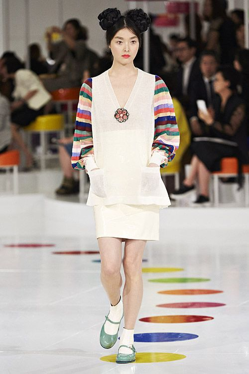 "How Chanel's Korean-Influenced Collection Got It Right #refinery29  Karl Lagerfeld for Chanel, cruise '15  ""...Some looks incorporated saekdongot, the colorfully striped, patchwork form of hanbok usually worn by children. (And although it's hard to tell in abstract form, that could either be South Korea's national flower, the rose of Sharon, or the classic Chanel camellia we spy decorating the model's V-neck.)"""