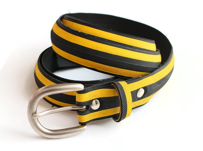Upcycled yellow and black striped tyre belt by Laura Zabo
