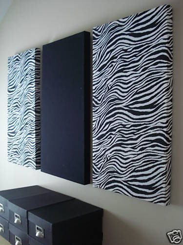 fabric over canvas... but do a zebra in the middle and two coordinating patterns on either side.  For above bed?