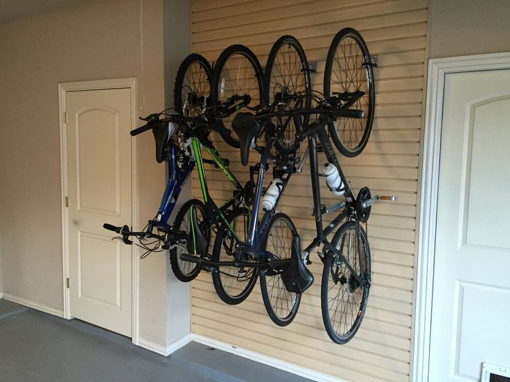 Slatwall bike S style hooks to hang multiple bikes close together in tight spaces