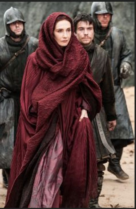Born a slave in Essos, Melisandre is now a Red Priestess of the Lord of Light. Hailing from Asshai, a country of the continent of Essos, she claims to wield magical abilities, esp. the power of prophecy. Her large ruby necklace seems to glow whenever she performs her magic. Some years ago she crossed the Narrow Sea and came to the court of Lord Stannis Baratheon on the island stronghold of Dragonstone to preach. She has become a close adviser to Stannis.