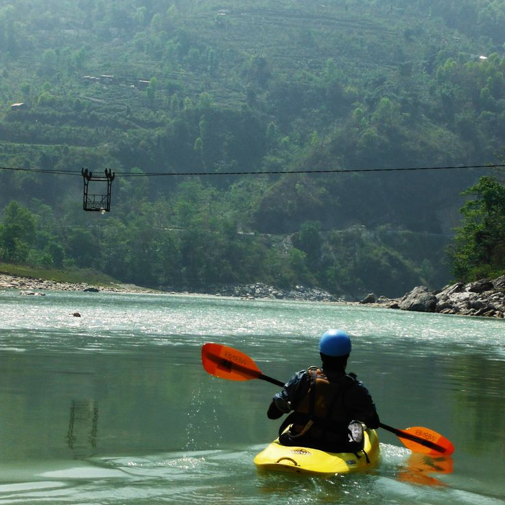 Two mums in a raft, leisurely drifting towards a fantastic creekside camp, with regular moments of raging whitewater rapids - Trishuli River, Nepal #TrishuliRiver