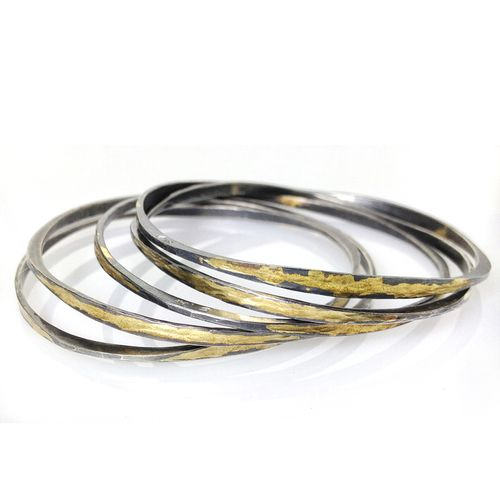 Ayesha Mayadas' Handmade Modern Splash Bangles are made from Oxidized Sterling Silver and 14K Gold leaf.