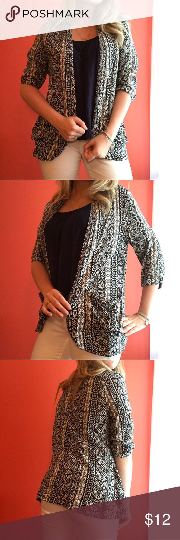 Tribal print cardigan/coverup! Tribal print cardigan/coverup! Forever 21 size medium. 3/4 sleeves and pockets. Cute with a top and jeans or as a beach cover up. Forever 21 Sweaters Cardigans