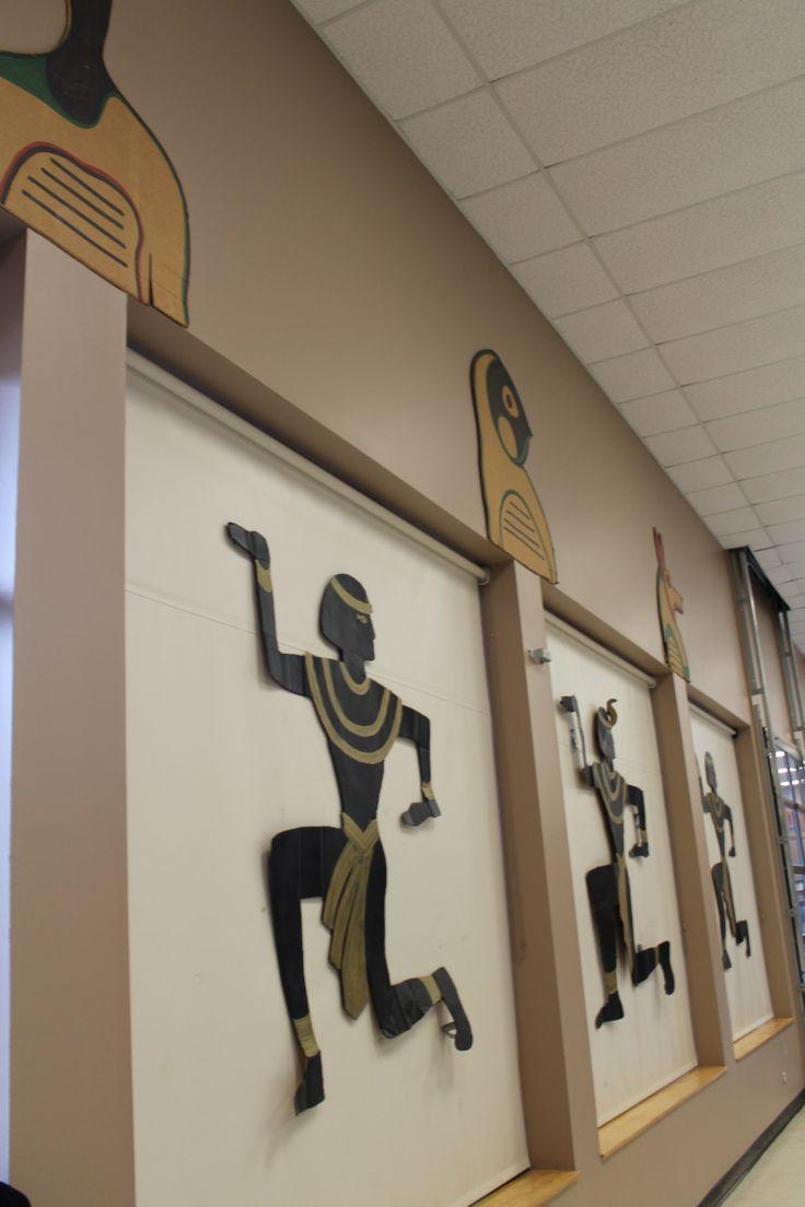 cardboard cutouts taped to vinyl shades