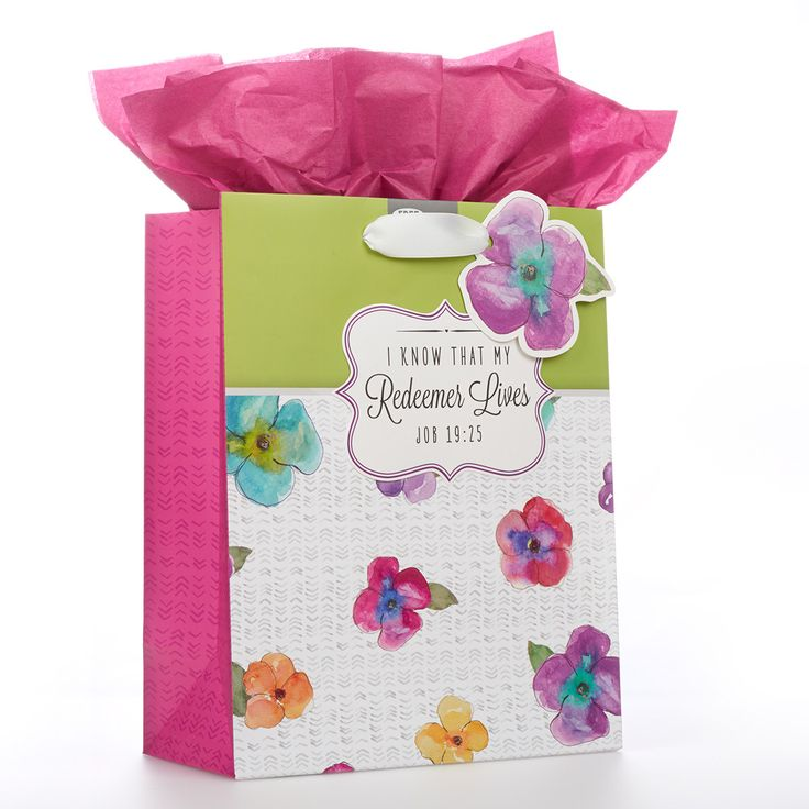 "Medium Gift Bag  Redeemer Lives Range  Floral   Constructed of heavyweight, coated paper. Features white satin ribbon handles, attached gift tag (floral design with ""a flower""), and an insert sheet of pink tissue paper.   * Heavyweight, Coated Paper  * Size: 20 x 12 x 24.5 cm  * Attached Gift Tag  * Pink Tissue Paper Insert  * Bible Verse - Job 19:25  PRICE: R35 per Bag."