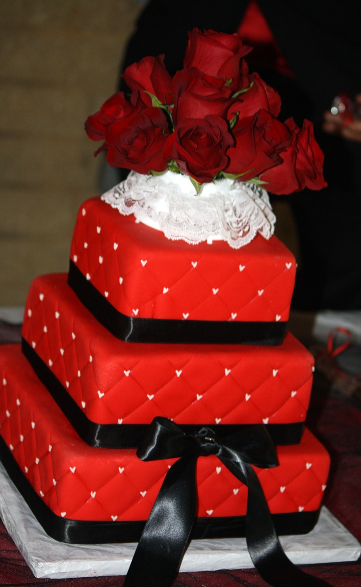 Quilted red fondant cake with black satin ribbon and white fondant hearts