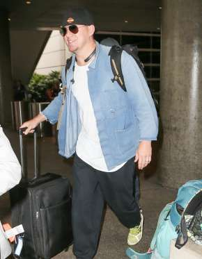 A smiling Channing Tatum arrives at LAX Airport. - Splash News Online