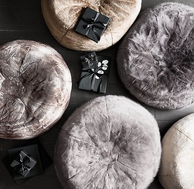 RH's Luxe Faux Fur Bean Bag - Wolf:A wrap of sumptuous luxury faux fur updates this relaxed 1970s icon. Comfortably oversized yet still portable, it provides sink-in comfort with all the indulgent softness of genuine fur.