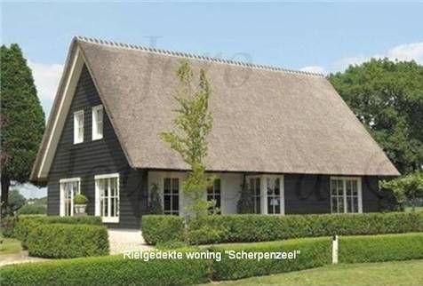 Rietgedekte woning scherpenzeel is een strak landelijk huis uitgevoerd met gevelbekleding van for Moderne stijl gevel