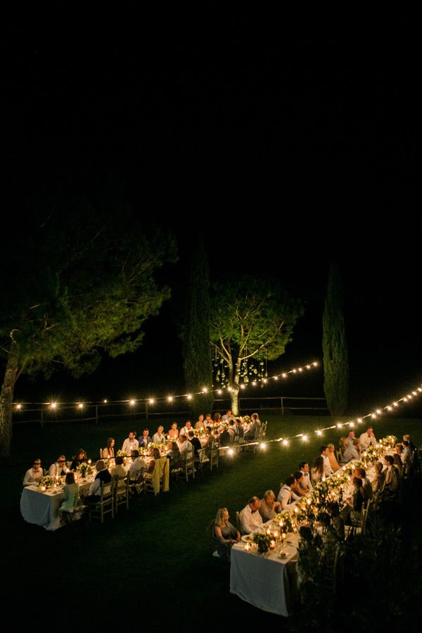 THIS. Strung lights. Long tables. Centerpieces and CANDLES running the length of the tables. LOVE!!   Lindsay Madden Photography