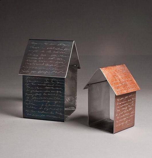"""""""Story Houses"""" - House shapes made from cold rolled steel with patina of black or copper applied to the exterior. Then text is engraved onto the house. The text is not legible, but rather serves to inspire the individual story."""